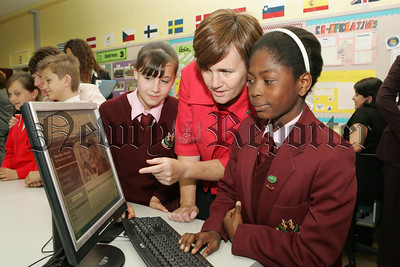 Minister for Education is pictured with pupils from St Mary's High School Newry, Mira Andruszkevicz and Mary Adegbamiye at the launch of a new multi-lingual website for Newcomer Parents. 07W26N5