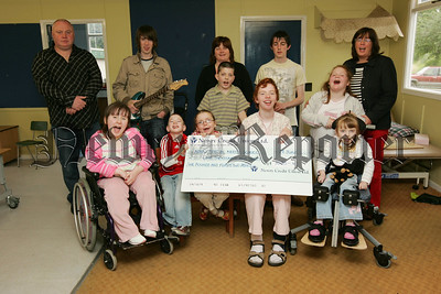 Pictured are pupils at Abbey Special Needs school who recieved a cheque from local band Adored the proceed of some of their takings at recent gigs, Pictured with the children are, Ciaran McEvoy and Aidan McCauley from Adored, Teachers Miss O'Shea and Mrs Hollywood along with Paul Donnelly. 07W27N13