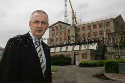 MLA Danny Kennedy pictured oppisite Bessbrook Mill which was used as a Army Barracks during the troubles. 07W26N36