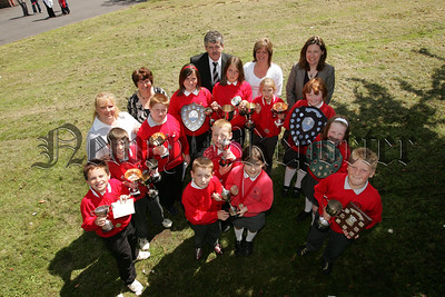 Pictured are major prizewinners at the end of year presentation at Bessbrook P.S. Also pictured are, Mrs J. Neill Vice Principal, Mrs L. Marks, Mr A. Maguire Principal, Mrs D. Cowan and Mrs H. Paul. 07W27N6