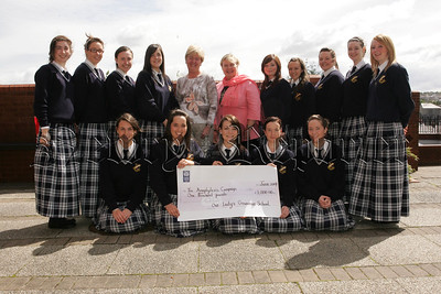 Pictured are upper 6th pupils from Our Lady's G.S. Newry who have decided to donate money made from a Fancy Dress Fundraiser to the Anaphylaxis Campaign due to the death of a close friend of many of the girls, Jane McVeigh in December 2006 as a result of an anaphylactic reaction. Pictured with the girls is Year Head Mrs Veronica Kearney and Principal Geraldine Pettigrew. 07W26N49