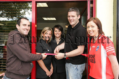 Jarlath Burns is pictured with Melissa McGuinness and Maria Kelly at the opening of Scissor Sister Camlough, also pictured is Martin O'Rourke and Marie Larkin  Armagh Ladies Camogie captain. 07W27N17