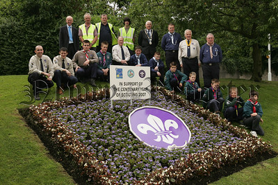 Mayor Michael Carr is pictured with members of the 1st Dromore St Colman's Scouts, Newry and 1st Earl of Kilmory Scouts at a commemorative flowerbed to show support for the Centenary Year of Scouting 2007. Also piuctured is Noel White, Robert Niblock, Niall McCauley and Kieran McCann from N+M District Council. 07W28N9