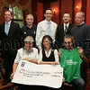 Martha McGrath from Macmillan Cancer Support recieves a cheque from Martina and Aiden Doyle for £1210 the proceeds of their participation in the Belfast City Marathon. Also pictured are, Sean Grant, Peter McElroy, Thomas Fitzpatrick, Conor Murphy and Eamonn Byrnes who also took part in the Marathon. 07W29N44