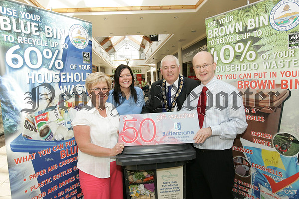 Peter Murray Manager of the Buttercrane Shopping centre presents a £50 gift voucher to the recycler of the month Lorraine Carroll. Also pictured are Mayor Michael Cole and Tara Cunningham Environment Officer. 07W31N25
