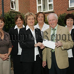 Gervase McCartan Chairman Newry Cancer Research recieves a cheque from the Newry and Mourne Council team which participated inthe Annual Cancer Research All day walk held in Frank Curran Par ...