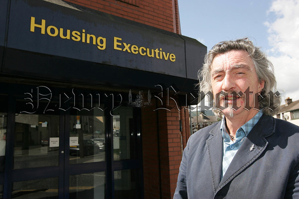 Micky Brady MLA pictured outside the Housing executive. 07W31N23