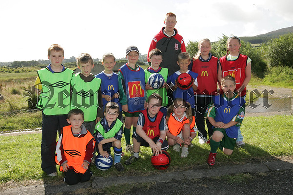 Coach Barry Mooney is pictured with participants of the Fr Cullen Park Summer Soccer Coaching schemes held last week.