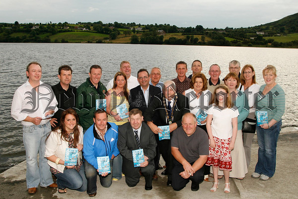 Pictured at the launch of Feile Chamlocha, Mayor Michael Cole, Conor Murphy (MP),Walter Bradley(chairman), Sponsors, Local Councilors and Feile Committee members pictured at Camlough Lake to launch the Feile which will run from the 6th to the 19th of Augest. 07W31N51