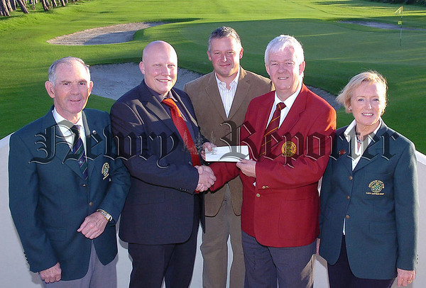 John McDonnell  of Cathedral Financial Services  Dundalk sponsors  of The Greenore  Golf Club Pro Am  presenting the  Sponsorship cheque to MIchael McCumiskey Secretary  of The PGA with from left  Ciaran McGooey Captain Greenore GC Robert Gyles Club Profesional and Lady Captain Ethna Dowling  (AKJ)