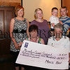 Mary Mc Parlan (seated left) presents a cheque for £15,917 for Macmillan Cancer Support to Martha Mc Grath (macmillan). Also included are Marie, Liam, & Lee Mc Parlan and Sharon Mullen. The Money was raised from a nite at the races, Auction, and a Raffle held in Macs Bar Hilltown, The Mc Parlan family would like to take this opportunity to express their thanks to all those who so generously supported their fundraising events in memory of Leona. 07W35N70
