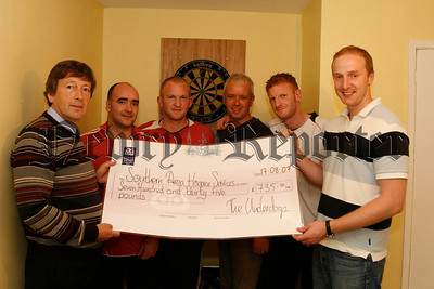 "A  fundraising darts challenge between ""The Underdogs"" and ""Mc Coys"" was organised by Mark Curran (son) along with friends Anthony Kearns, Gary O'Connor and Peter & Cathal Mc Cartney in memory of  Paddy Curran who died recently and raised £735 for the Southern Area Hospice Services was presented to Pat Trainor ( hospice fundraiser, left), The underdogs won the match by 7 legs to 1, 07W35N56"