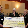 """Eileen Sands (left) and Geneviveve Mc Gahan (right) present a cheque for £875.00 to Mairin Sands (hospice), The money was raised at a """"Night of the races"""" in the Orchard Bar, 07W35N55"""