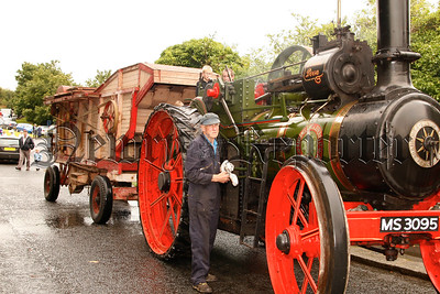 George Henry puts the finishing touches to his steam engine before the start of the parade, 07W35N59