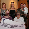 Marie Mc Parlan presents a cheque fro £1610,65 for Macmillan Cancer Support to Martha Mc Grath, Also in cluded are Sharon Mullen, Lorraine Fegan, Mark Campbell & Lee Mc Parlan, The money was raised through taking part in the Belfast Marathon in memory of Leona Mc Parlan. 07W35N71