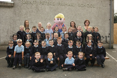 Pictured are the New Primary 1 class at St Peter's Primary School Cloughreagh with Bob the Builder and Teachers, Roisin Morgan, Jacinta McConnon, Chyney McCrink and Nicola Pierce. 07W37N8
