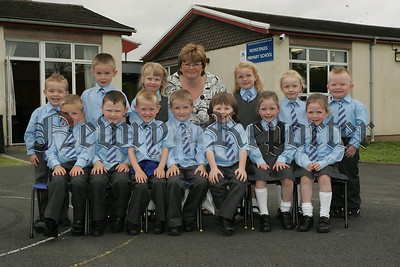 Pictured with their teacher Mrs Pauline Neill are the new Primary 1 class at Poyntzpass Primary School.  07W37N3