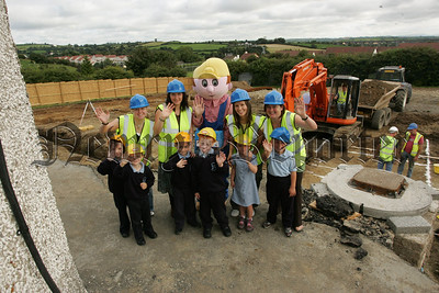 Pictured with Bob the Builder who managed to take some time out of his busy schedule to oversee the building of a new school for St Peter's Cloughreagh are some of the new Primary 1 class at the school with teachers, Roisin Ward, Jacinta McConnon, Chynel McCrink and Nicola Pierce. 07W37N7