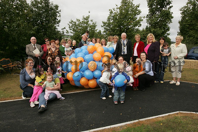 Pictured are parents and children of Orana Surestart with Mayor Michael Cole, Margaret Richie MLa and Cllr Karen McKevitt at a baloon launch to mark the release of this years annual Surestart calender. 07W38N21