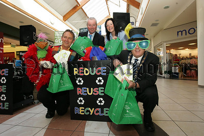 Pictured with Mayor Michael Cole at the launch of the Green Re-useable bag campaign are, Marvin the Magician, Patrick McShane and Tara Cunningham. 07W38N20