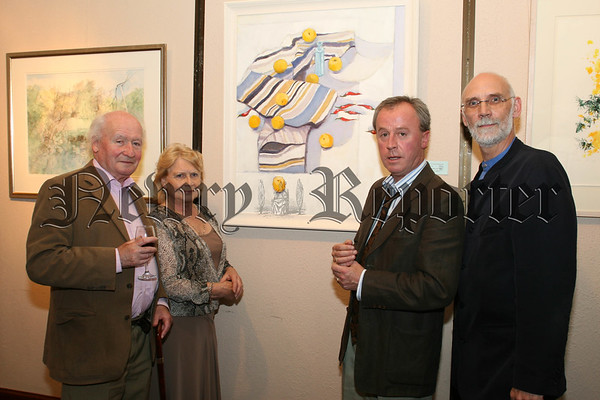 Ulster Arts Club are holding their Members Annual Exhibition in Sean Hollywood Arts Centre which is ongoing at present, Pictured at the first night were l-r T.P.Flannagan (president ulster art club), Elizabeth Holt (council member), Peter MacHugh (chairman ulster art club) and Kevin Mc Carry (newry art committee), The Ulster Art Club are celebrating 100 years and this is their first time in Newry. 07W38N51