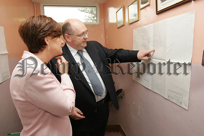 Minister for Education Caitriona Ruane MLA is pictured looking at the plans for a New school at Dromintee Primary School with Stephen Begley Chairman of the Board of Govenors. 07W38N9