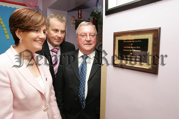 Caitriona Ruane MLA Minister foe Education unviels a plaque to mark the occaision of her visit to St Oliver Plunketts Primary School in Forkhill, aslo pictured are School Principal Mr Ciaran Mackin and Pat Toner. 07W38N4
