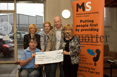 Members of the Martin Lenaghan family present a cheque for £2850 to members of Newry MS Society. 10W45N1