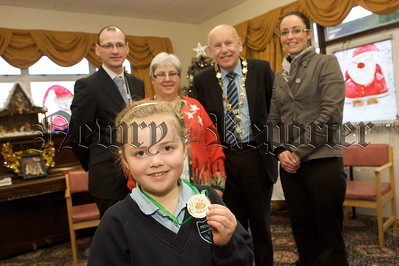 Janet Cartmill from Mullaglass PS recieves her medal for participation in Cloughreagh House art competition. 10W51N7