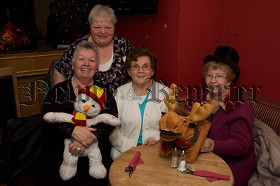 Philomena Cunningham, Maureen McQuaid, Bridgid Turley and Betty Fitzpatrick are pictured at Christmas Dinner in The Phoenix Bar. Proprietor Betty Fitzptrick invited residents from various care homes for a free christmas dinner with entertainment afterwards. 10W51N12