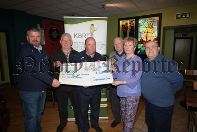 Collie Bell and Kevin Heaney from the KBRT accept a cheque for £1620 from Jackie Mallon, Paddy Smith, James Martin and Asumpta Hyland money raised through a fundraiser held in the Independent club recently. R1617008