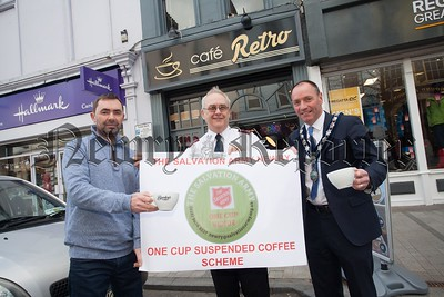 Mickey Ruane and Major John Parrott are pictured with Warren McIntosh from Café Retro who were the Fisrt local business to adopt the Salvation Army's One Cup Suspended Cofee Scheme. R1617024