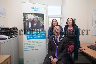 Newry, Mourne and Down DC Chairperson Mickey Ruane is pictured with Ann Ward and Hazel Mayger from the alzheimers Society at the launch of Sode by Side Service. R1617001