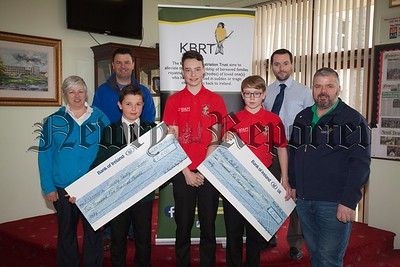 Pupils at St Joseph's Boys' HS Newry Luke Keenan, James Boyle and Cailum Kilcoyne present cheques totalling £5000 to Kevin Heaney (KBRT) and Pauline Murphy along with Joe McKinley (Alzheimers Society) the proceeds of their recent 24hr Spinathon. Also pictured is Teacher Mr Mark Gallagher. R1618004