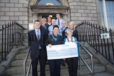 Customers and Staff at the Newry branch of the Bank of Ireland raised £500 for Newry Gateway Club from a raffle of a Christmas Hamper during the Christmas period. Pictured with staff members is Patricia McCann. R1617009