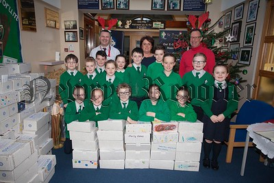 Pupils from St Ronan's PS School Council are pictured with Paddy loughran from the Rotary Club who collected shoeboxes from the school as part of the Rotary Club's Shoebox Appeal. Also pictured are Kevin Donaghy and Patrina Farrell. R1650012