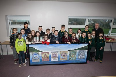 St Mark's High School Warrenpoint collabarated with local Primary schools, Dromore Road, St Dallans, Kilbroney Integrated and St Bronaghs to design and make a Mosiac Tile Artwork as part of the Extended Schools Project 2016. Pictured with the pupils ar Sinead Ward and Brian Lambe. R1651013
