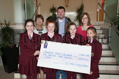 Barry Traynor is pictured with pupils at St Mary's HS Newry who presented him with a cheque for £2300 for Zambian Street Children. Also pictured is Principal Margo Cosgrove and Head of RE Teresa Kearney. R1722001