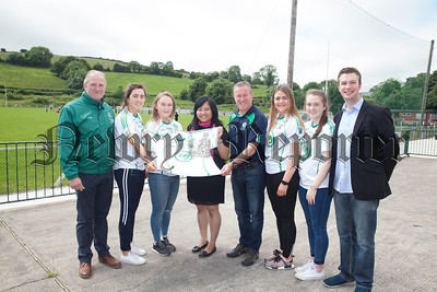 Yan Lin Director Confuscus Institute presents Jerseys to Player and Management at Shane O'Neill Camlough. RS1725014