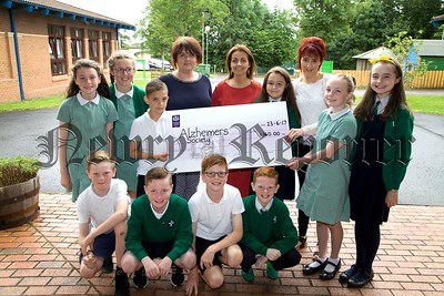 ST RONANS PRIMARY SCHOOL CHEQUE PRESENTATION TO ALZHEIMERS SOCIETY.