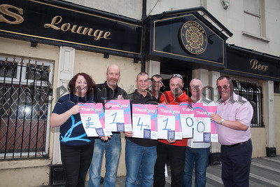 McGuigan Pool team have raised an incredible £14000 for THe Alzheimers Society in just 10 Months. Pictured with Maeveen Brown are Brian Campbell, Joey Magill, John Magee, Dusty O'Hagan, Mike McArdle and Gerry McGuigan. RS1726001