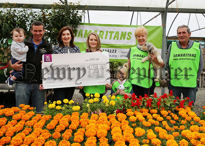 Pictured at the Cheque presentation to Samaritans proceeds of the recent Coffee Morning & Cake Sale in O'Neills Flowers Willille are Cian & Gearoid O'Neill, Concepta O'Rourke, Sarah & Isabella Finnegan, Patricia McCormack & Michael Rogan.