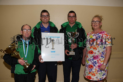 Desmond McAllister, Twins Sean and Hugh O'Gorman with Elaine Cole (Coach United Clubs Football Team) holding their trophies as 2nd in the overall Football competition beating off 18 other teams at the Geneva European Football Games. R1726207