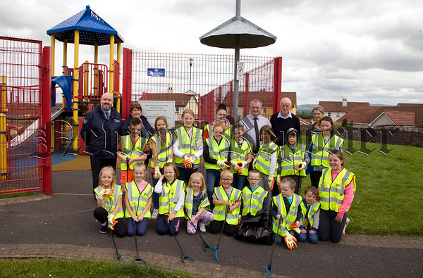 Children from the Martins Lane area pictured at thier clean up on Monday with Andrew Kernaghan from the PCSP, Maureen Ruddy, chairperson Martins Lane area community association, Aidan Mallon and Ciaran McCann and Kerrie Morrow from NMDDC. R1727013
