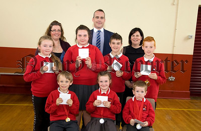 Bessbrook P.S held their school awards cermony last Friday and pictured here are Academic Award winners with Principal Mrs Hunter, special guests Richard Melaniphy, V.P Newry and Mrs Archer. R1726022