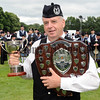 Ecstatic with excitement and pride:  <br /> Dessie Moorehead (Bessbrook Crimson Arrow Pipe Band) pictured ecstatic with excitement and pride after receiving the Grade 4B All-Ireland prizes for best pipes (cup) and second place overall (shield) at the All-Ireland Pipe Band Championships at Lurgan Park on Saturday 1st July 2017.