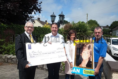 Michael Hannaway from Marie Curie accepts a cheque for £2650 the proceeds of a fundraising day held in memory