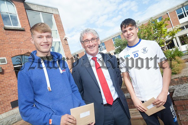 St Colman's Principal Cormac McKinney is pictured with Rian O'Neill and Keyon Mehrtash. R1734012