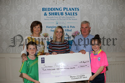 PATSY MCSHANE FLOWER AND PLANT SALE PRESENTS CHEQUE TO S.A.HOSPICE