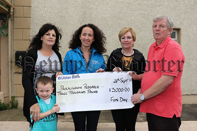 CHEQUE PRESENTATION FROM ST MARYS COMMUNITY HALL, HOUSING EXECUTIVE AND INDO
